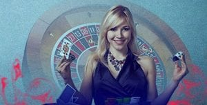 Top Online Casinos | Express Casino - Best Deposit Match Offers! | blonde women in black dress standing infront of roullete wheel