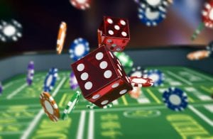 online-games red dice and pokerchips falling on to roulette table