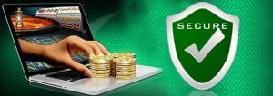 Coolplay Casino Online Casino Slots | secure payment green shield and macbook with hand pushing chips coming out of the screen