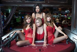 poketwin 4 girls in red underwear on blackjack table