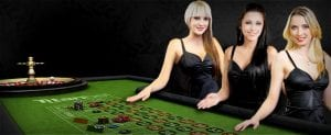 three sexy girls in black dress at roulette table